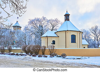 Old church and the bishop's castle. Winter landscape.