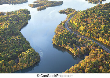 Curving road along Mississippi River during autumn - Curving...
