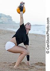 Model Kettlebell beach training