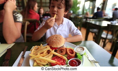 hamburger - children eating delicious hamburger