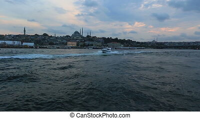 galata bridge and speed boat at istanbul turkey