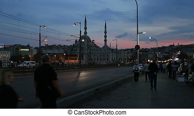 walking people at sunset - people walking on the Galata...
