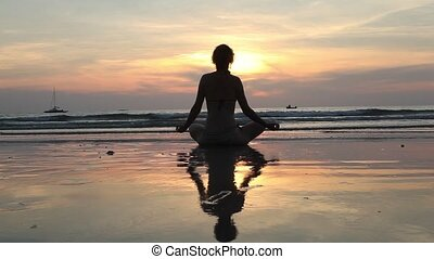 Silhouette woman practicing yoga,HD