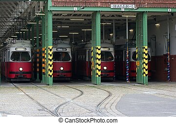 Trams - Four red trams waiting in the garage