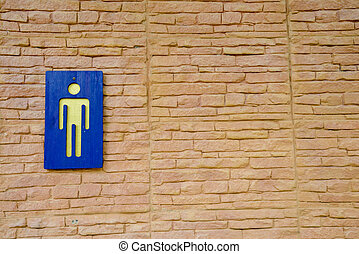 Toilet sign on wall