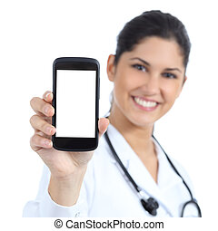 Beautiful female doctor smiling and showing a blank smart...