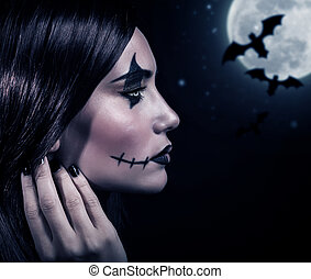 Terrifying witch in Halloween night - Side view of...