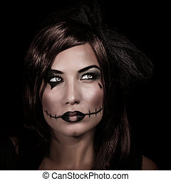 Halloween party - Scary woman portrait isolated on black...