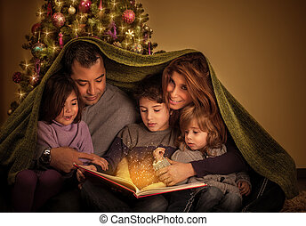 Big family in Christmas eve - Big family reading interesting...