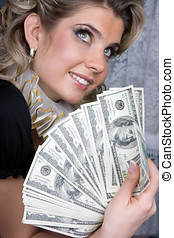 Poker girl with dollars in hands