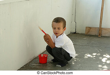 Toddler painting balcony wall