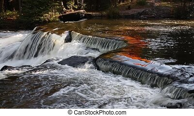 Bond Falls in Autumn Loop - Colorful fall foliage is...