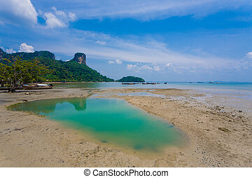 stagnant water on low tide beach