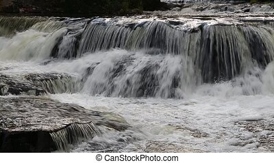 Bond Falls Cascade Loop - Water cascades over rocks at Bond...