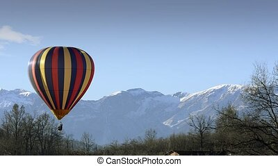 hot air balloon in flight over moun