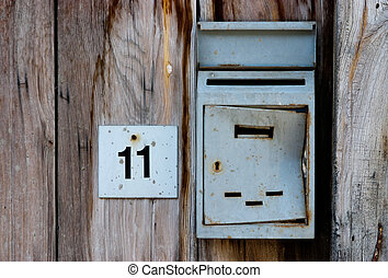 Letter box - Old letter box and house number on an old...