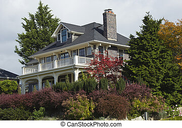 A mansion surrounded by plants Seattle WA. - A large mansion...