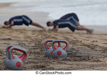 Beach fitness - Push-ups and kettlebells on the beach