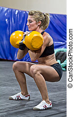 Model Kettlebell gym training - Model using fitness...