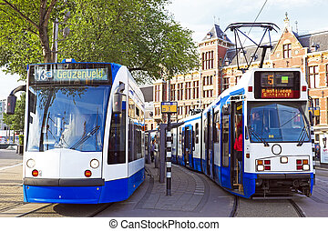 Trams waiting in front of the central station in Amsterdam...