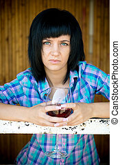 The young girl with a wine glass