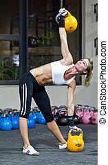 Model Kettlebell gym training - Model using fitness...