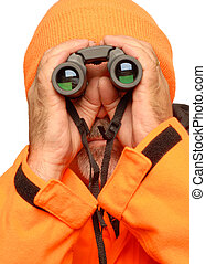 hunter with binoculars - hunter dressed in orange reflective...