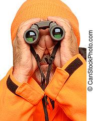 hunter with binoculars - hunter dressed in orange reflective...