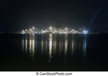 Industrial harbor at Kochi at night, Kerala, India