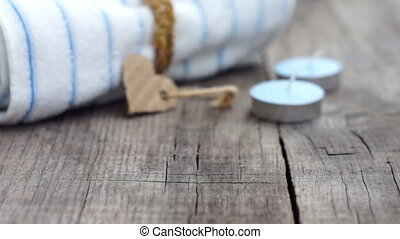 Time To Relax - A towel with a paper heart and candles on...