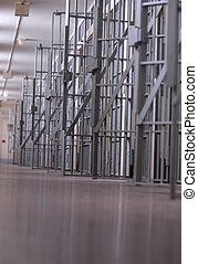 prison or jail - row of open jail cells or a cell block