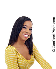 Young black woman smiling in yellow sweater
