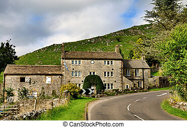 Stone built cottage by a road