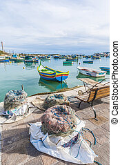 Kajjik Boat at Marsaxlokk harbor in Malta. - Traditional...