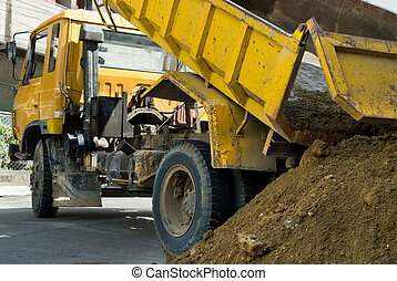 Truck unloading sand - Truck or lorry unloading gravel or...
