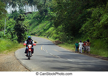 Traffic on poor Asian highway - Traffic of pedestrians and...
