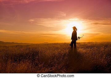 Bowhunter at Sunset