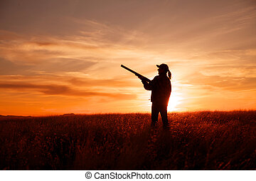 Bird Hunter at Sunset - a bird hunter with shotgun...