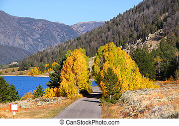 Scenic lake shore deive - Hebgen lake shore in autumn near...