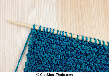 Garter stitch in teal yarn on knitting needle - Length of...