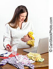 Pregnant Woman Shopping for Baby Supplies Online - Cute...