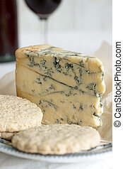 Stilton cheese on aged parchment paper with oat biscuits....