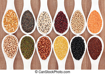 Pulses - Dried pulses food selection in white porcelain...