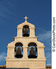stone bell tower with a blue sky background