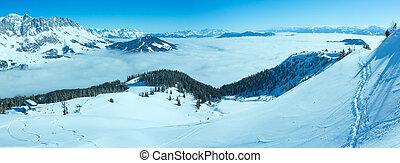 Cloudy winter mountain panorama. Ski resort. - Morning...