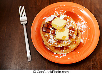 waffles with powdered sugar and syrup