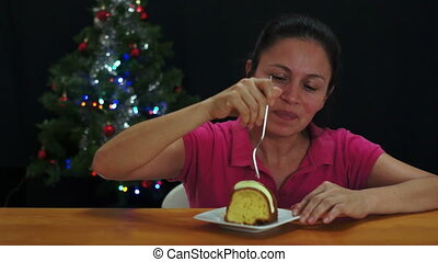 Woman Eating Christmas Cake - Middle aged latina, hispanic...