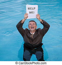 Senior man holding help me paperwork in water - Senior...