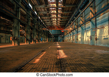 Dark industrial interior of an old building
