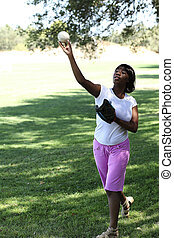 Young African American Woman Throwing baseball Park - Black...